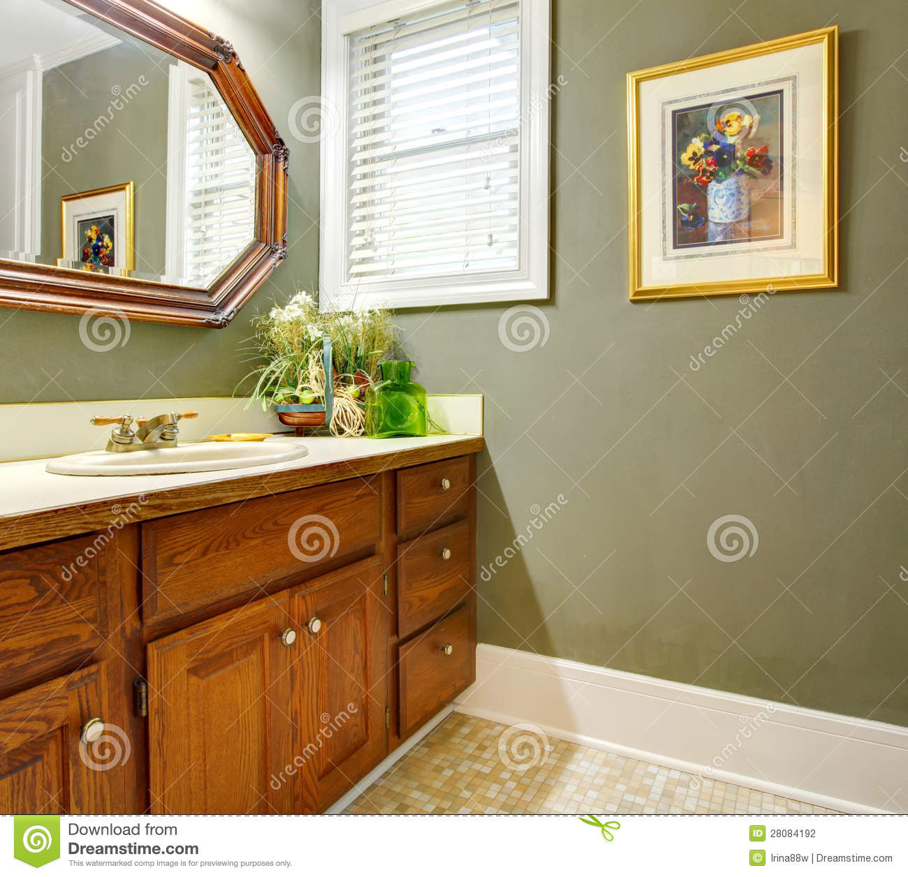 Classic Simple Green Bathroom With Wood Cabinets Stock