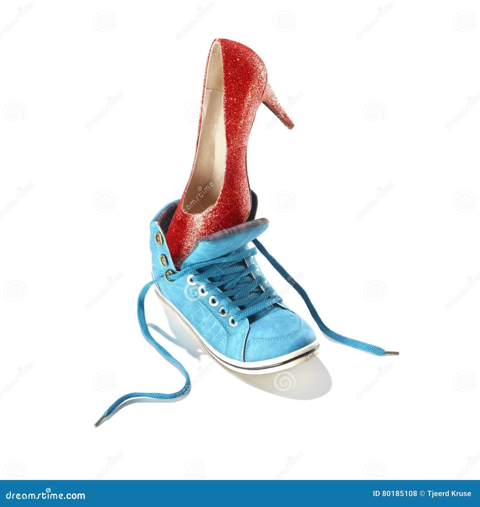 36cd3fb108c5 Classic stiletto high heels shoe in a red snake-print design put in a blue  sport shoe