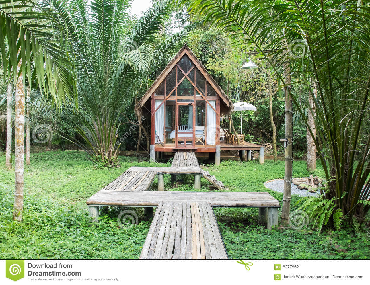 Classic style wooden house in the cottage with the wooden path in front of the house surrounded - Wooden vacation houses nature style ...