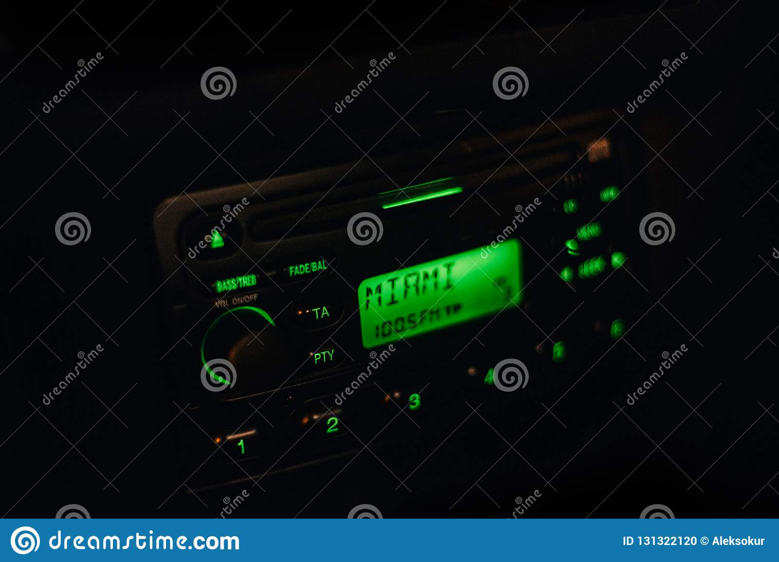Classic vintage car radio with cool green backlight