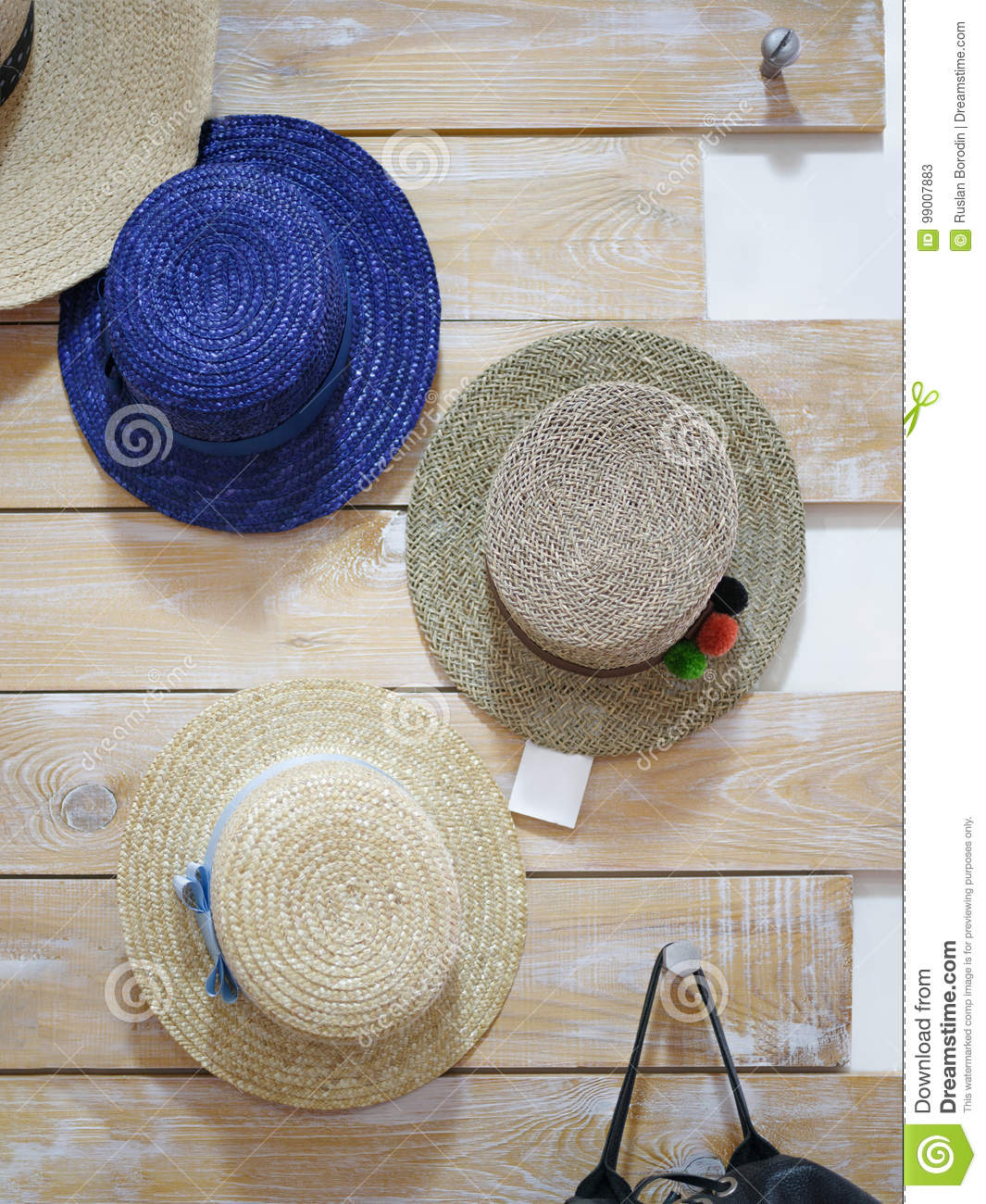 4059760e996 Handmade Pretty Women Hats. Classic Summer Hats Hanging In A Store ...