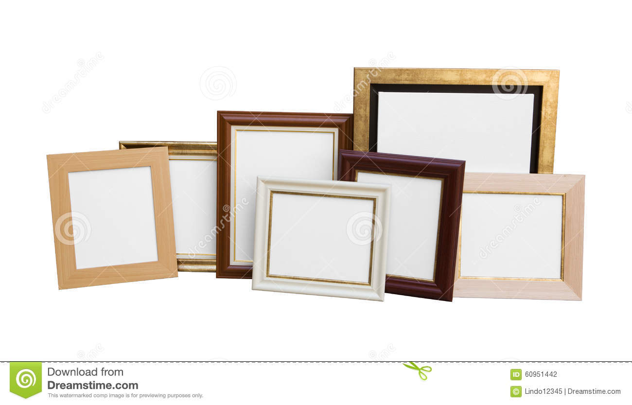 Classic wooden picture frames with blank canvas isolated