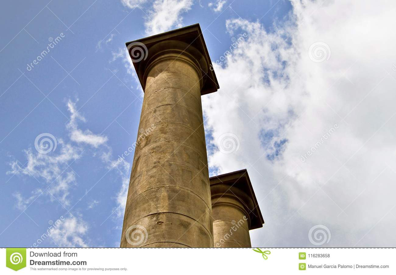 Classical columns under blue sky in Barcelona Spain
