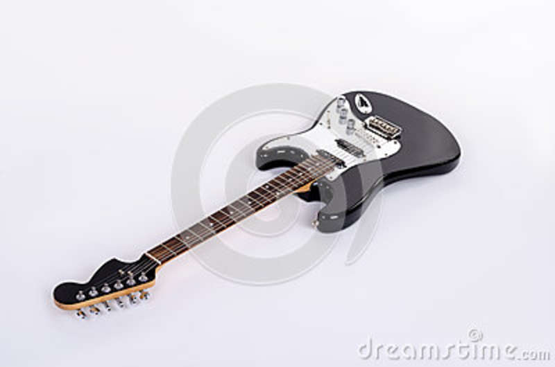 The classical form of black and white electric guitar lies horizontally with wooden maple neck