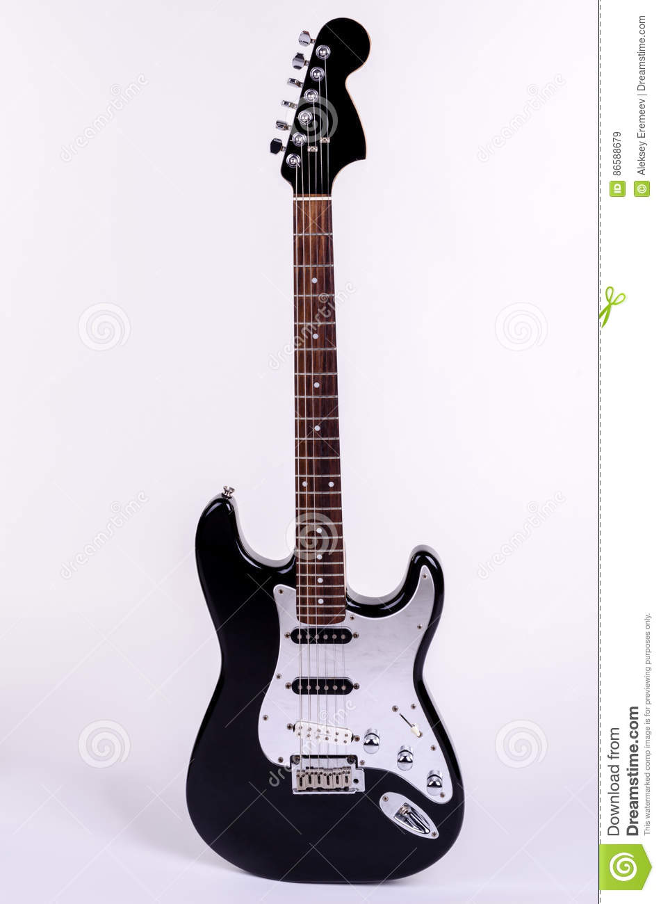 The classical form of black and white electric guitar standing upright with wooden maple neck
