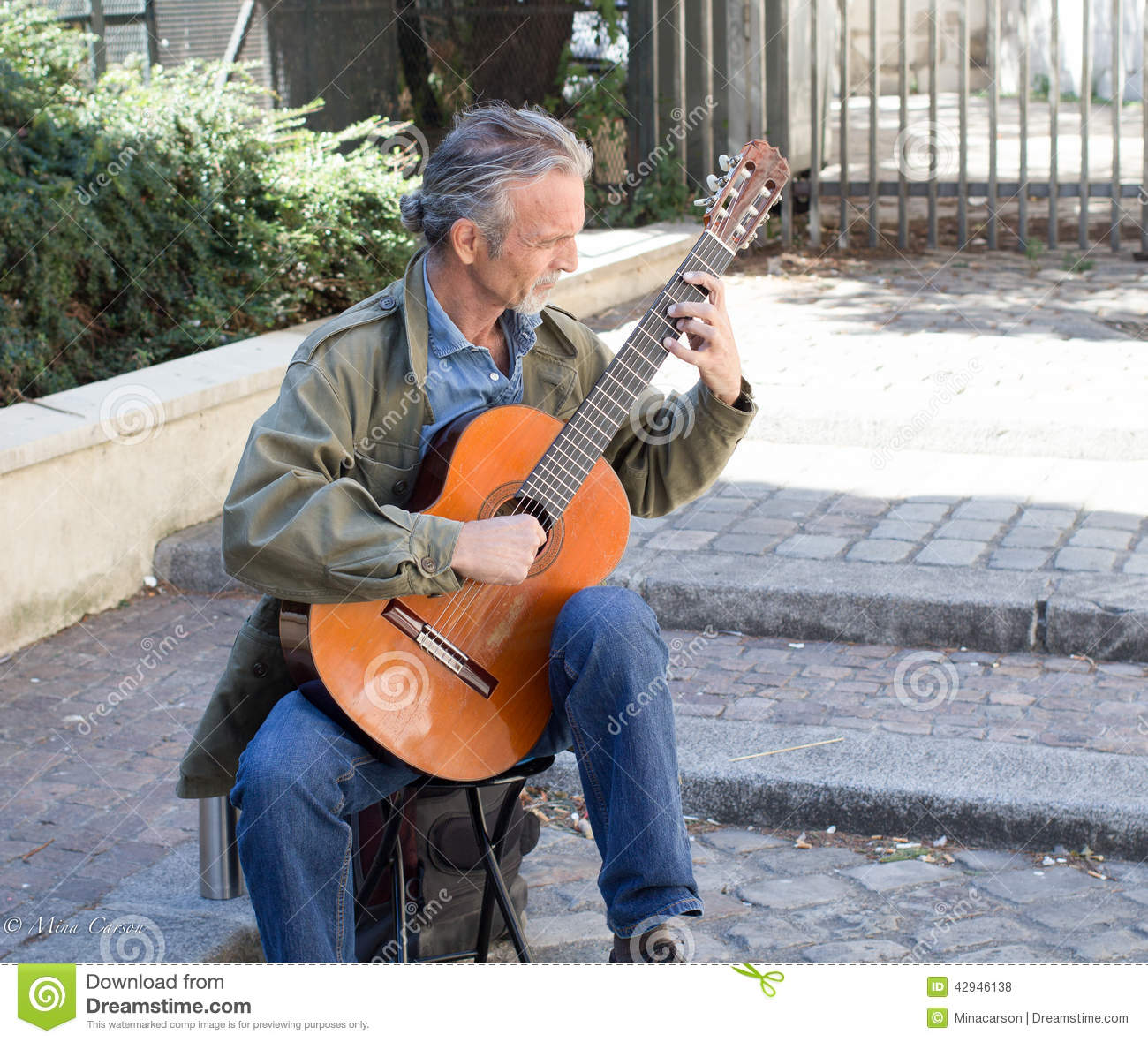 classical guitar player in a paris courtyard editorial stock photo image 42946138. Black Bedroom Furniture Sets. Home Design Ideas