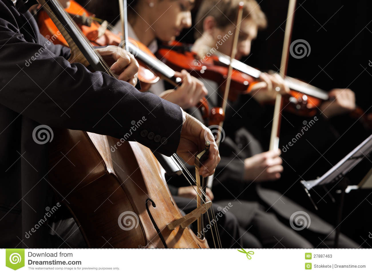 Symphony concert, a men playing the cello, hand close up.