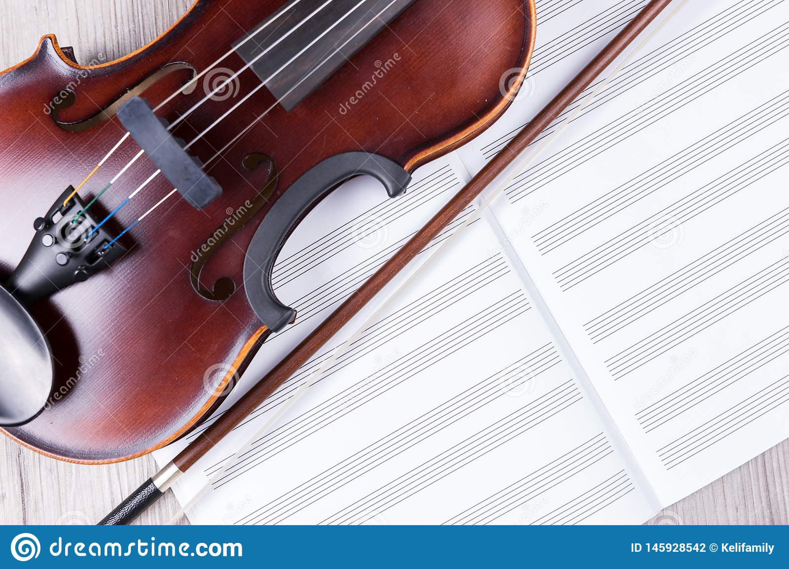 Classical Violin With Empty Music Sheet Book  Studio Shot Of