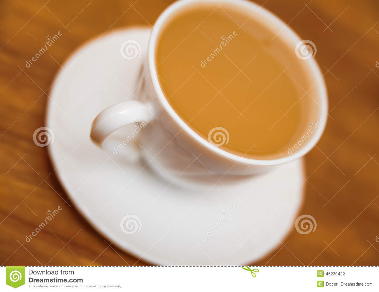 Classical white cup of milk coffee on table blur backgrounds