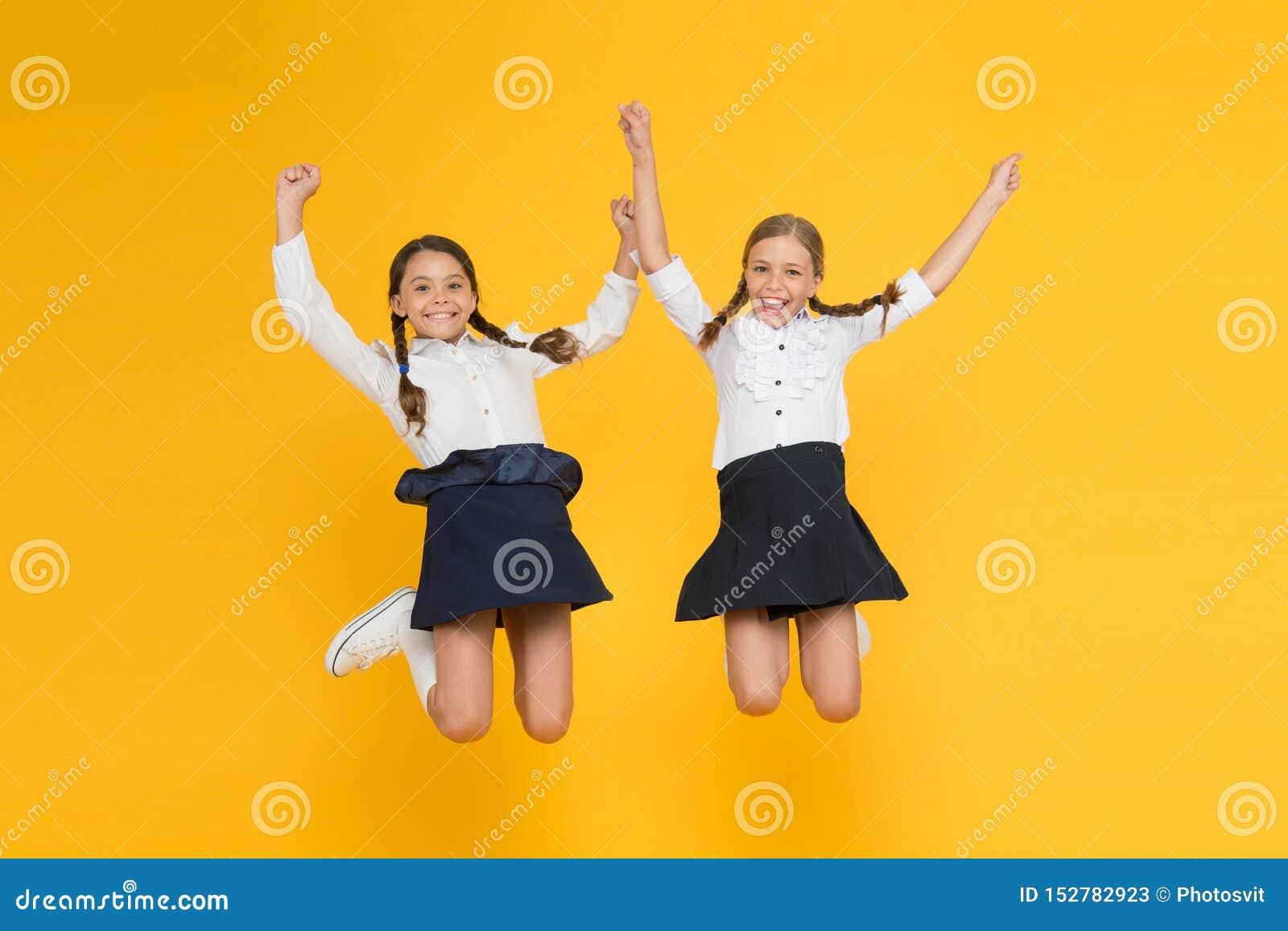 Classmates having fun at school Friends adorable pupils. Schoolgirls formal style perfect school uniform. Happy