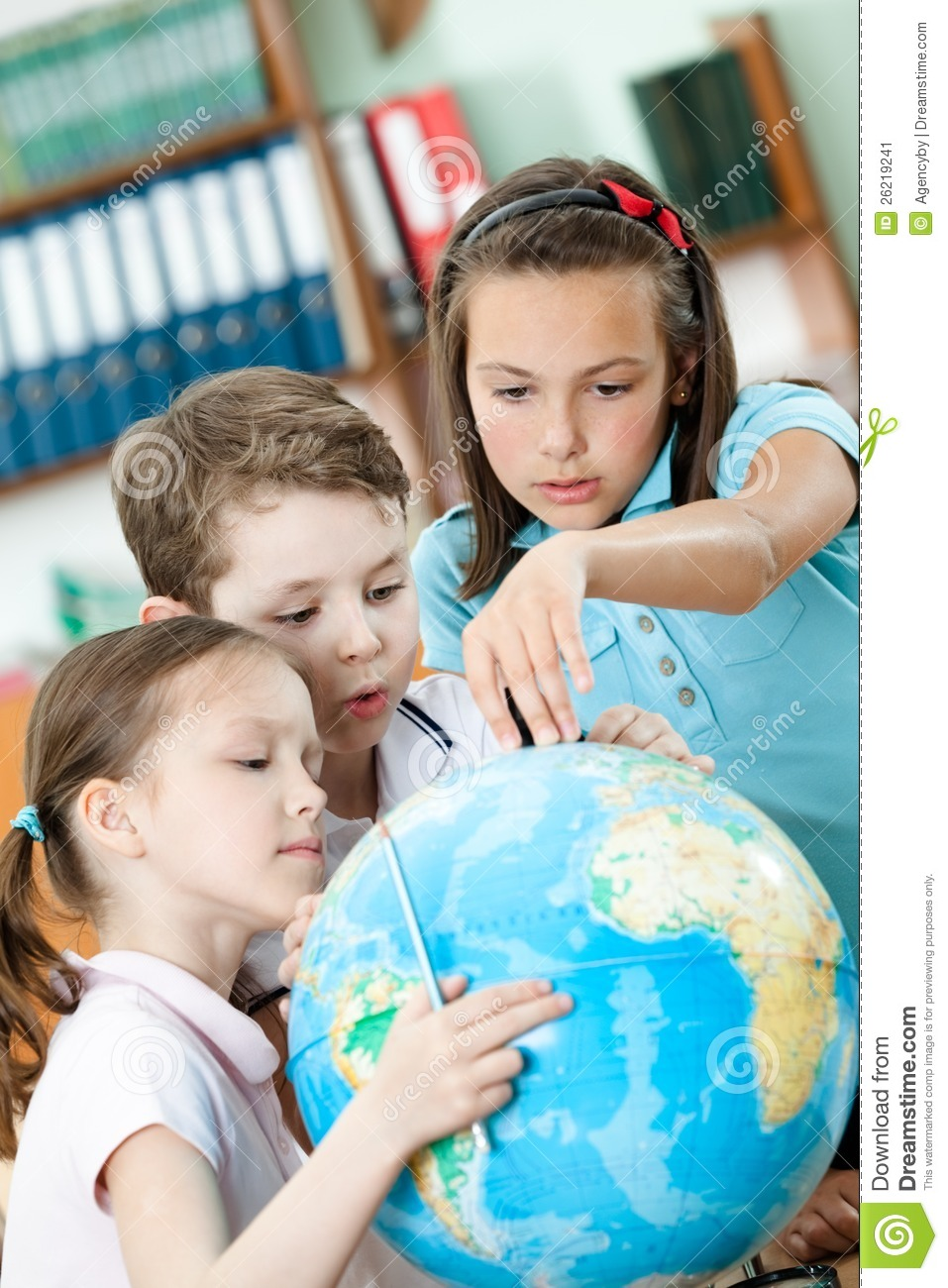 Classmates help to each other to find something stock image image