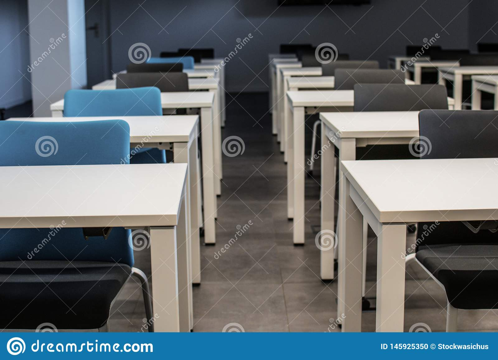 Classroom empty. High school or university desk or table with a pen on top