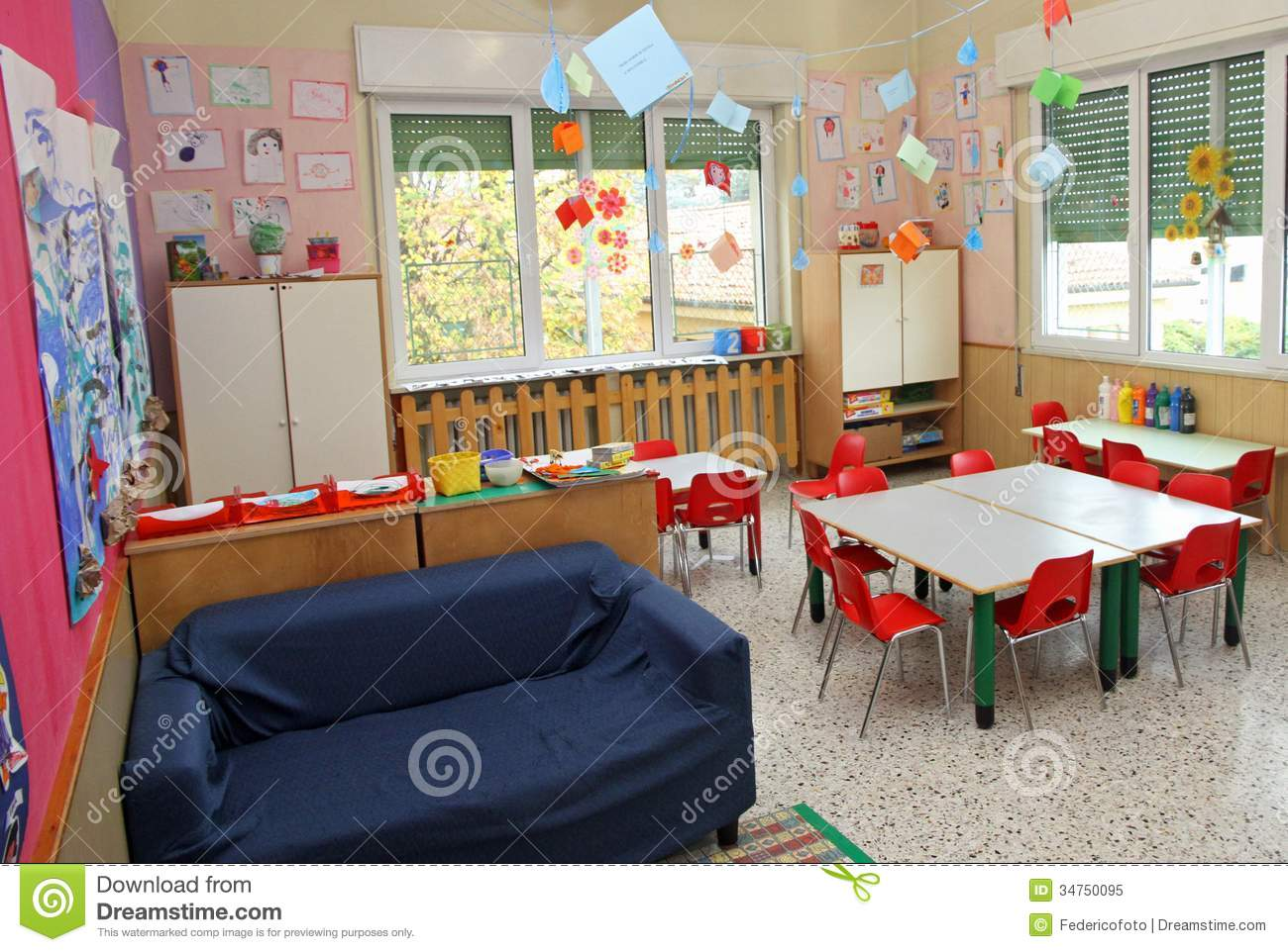 classroom in a kindergarten with tables and chairs and blue sofa stock image image 34750095. Black Bedroom Furniture Sets. Home Design Ideas