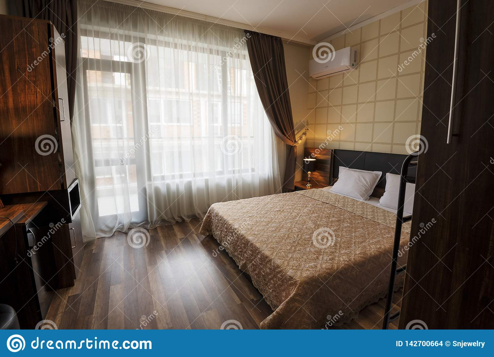 Classy Bedroom Interior Design Large Bed Room With Brown Color Tone Furniture Windows With Long Curtains Drapery And Sheers Stock Photo Image Of Classilassy Drapery 142700664