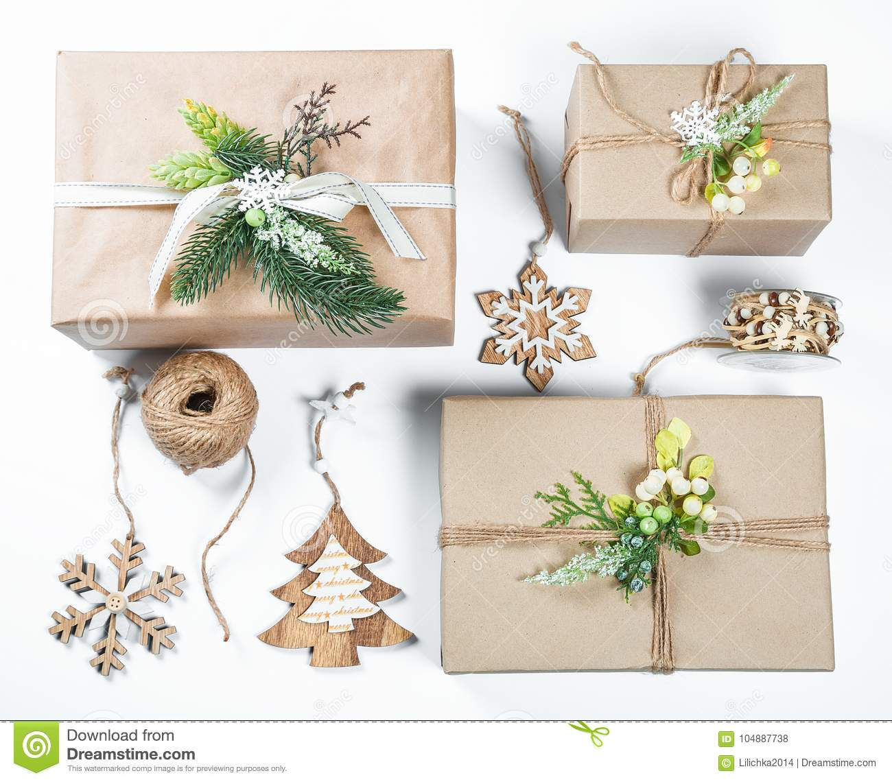 Classy Christmas Gifts Box Presents In Brown Paper With Toys And New ...