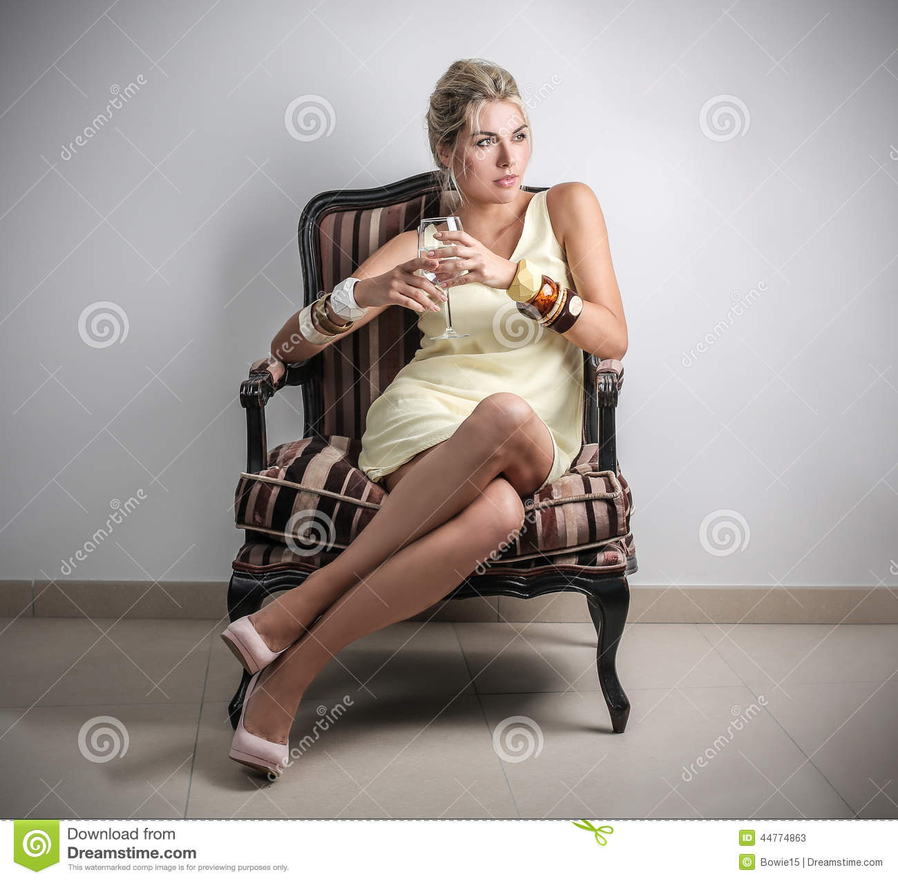 Classy woman stock photo image 44774863 for Sitting in armchair