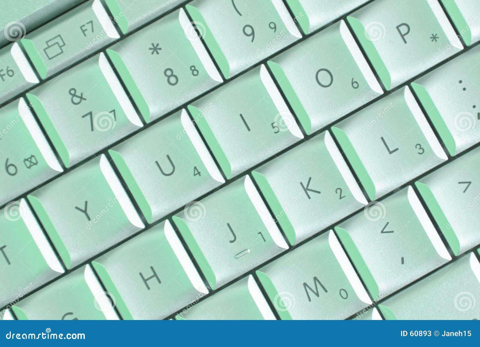 Claves de la computadora portátil en luz verde