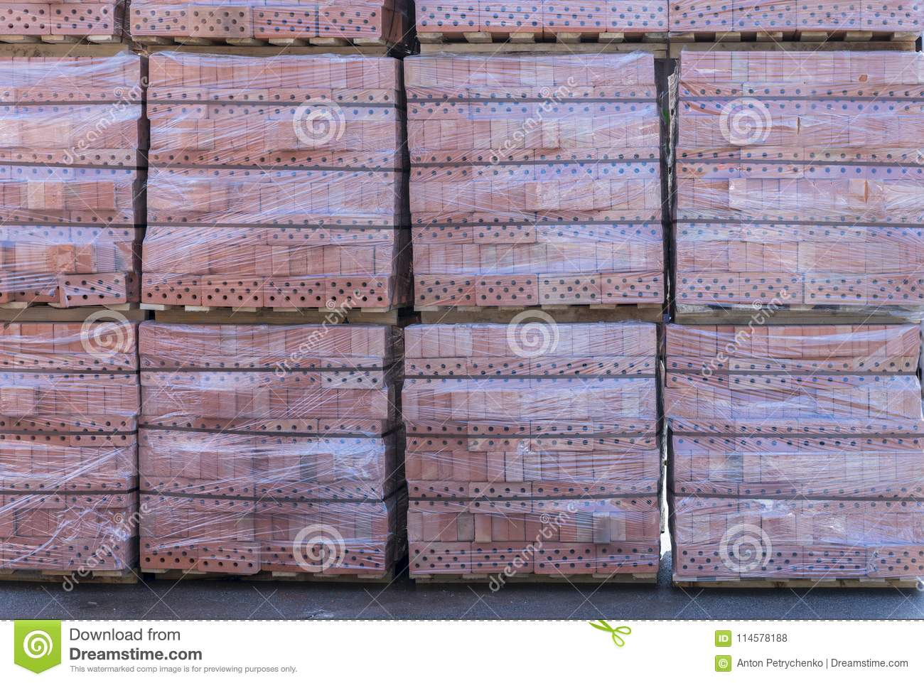 Clay brick s pallet at the storage yard. pallets with bricks in the building store. Racks with brick. Masonry, stonework.