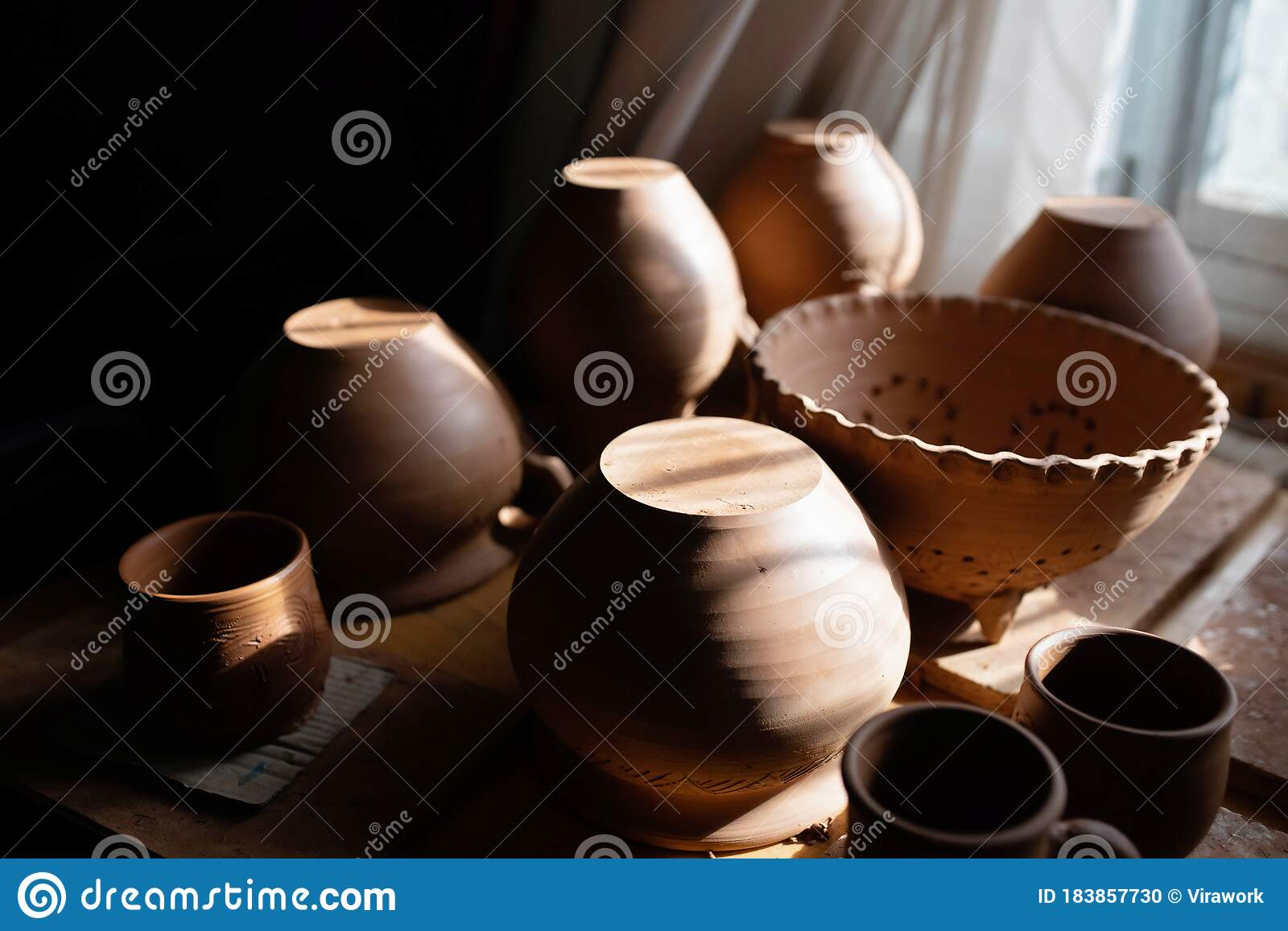 Clay Plates Bowls Cups In The Rays Of The Setting Sun Stock Photo Image Of Archeology Earthenware 183857730