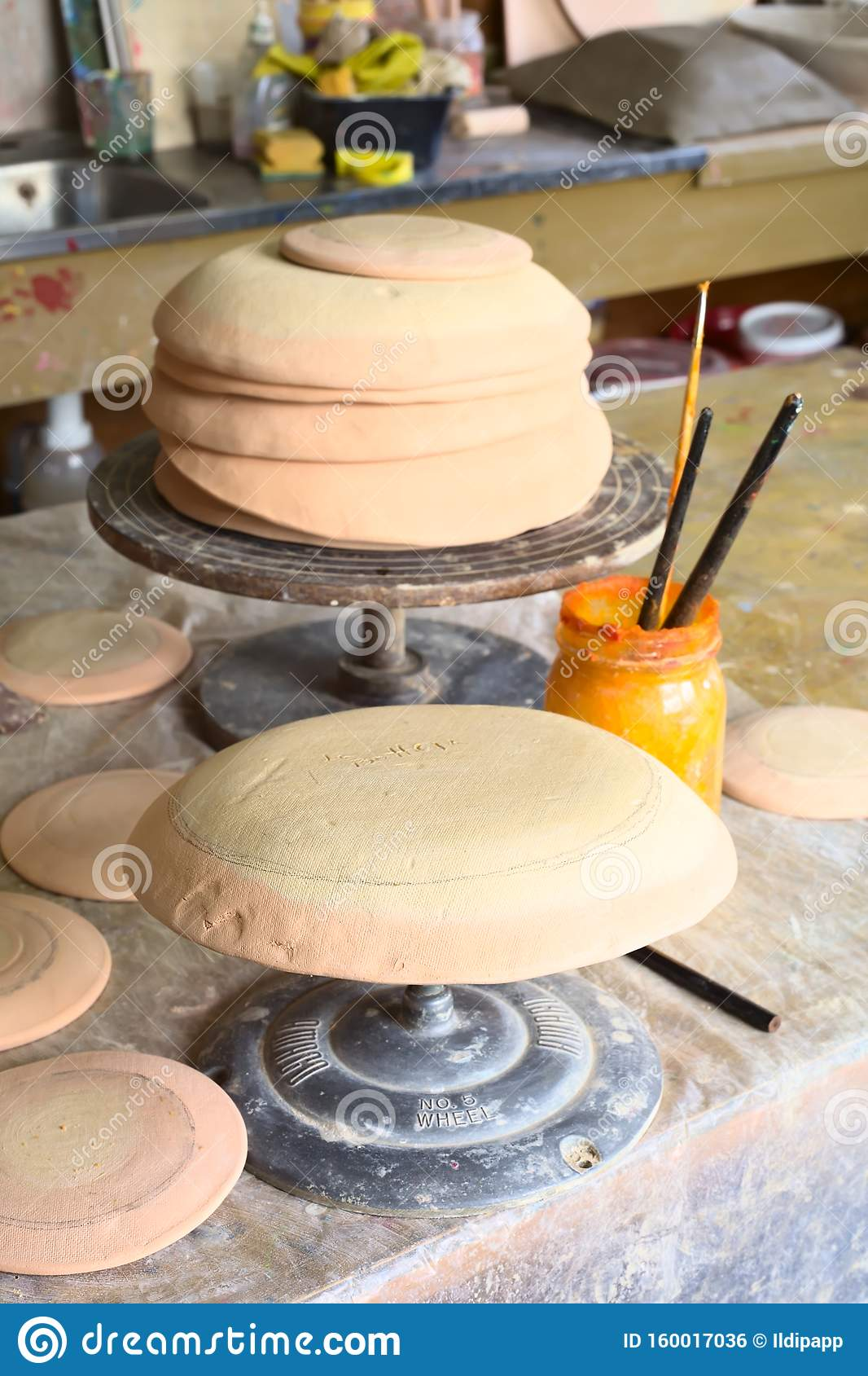 Clay Plates And Bowls On Pottery Wheel In Pottery Workshop Editorial Photo Image Of Fired Decoration 160017036
