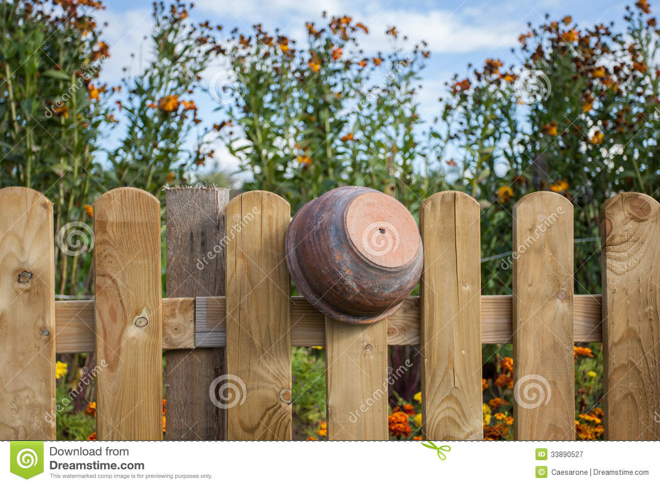 Clay pot on the fence