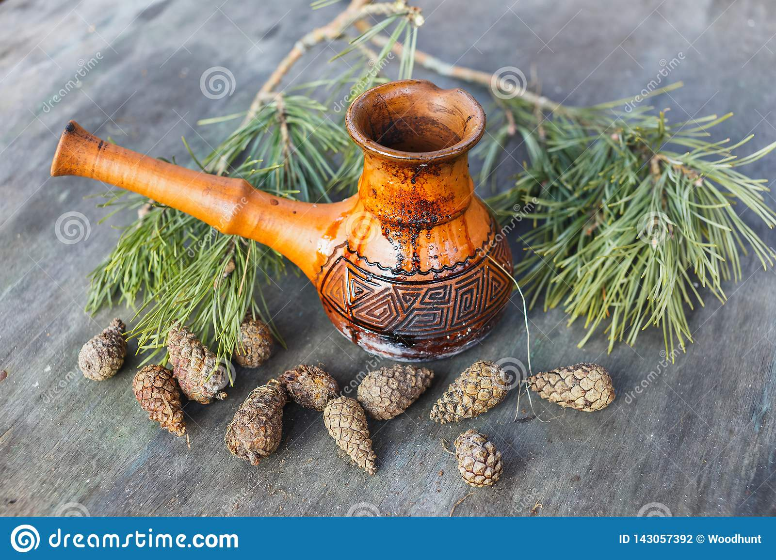 Clay Turkish coffee pot on the background of a gray wooden table