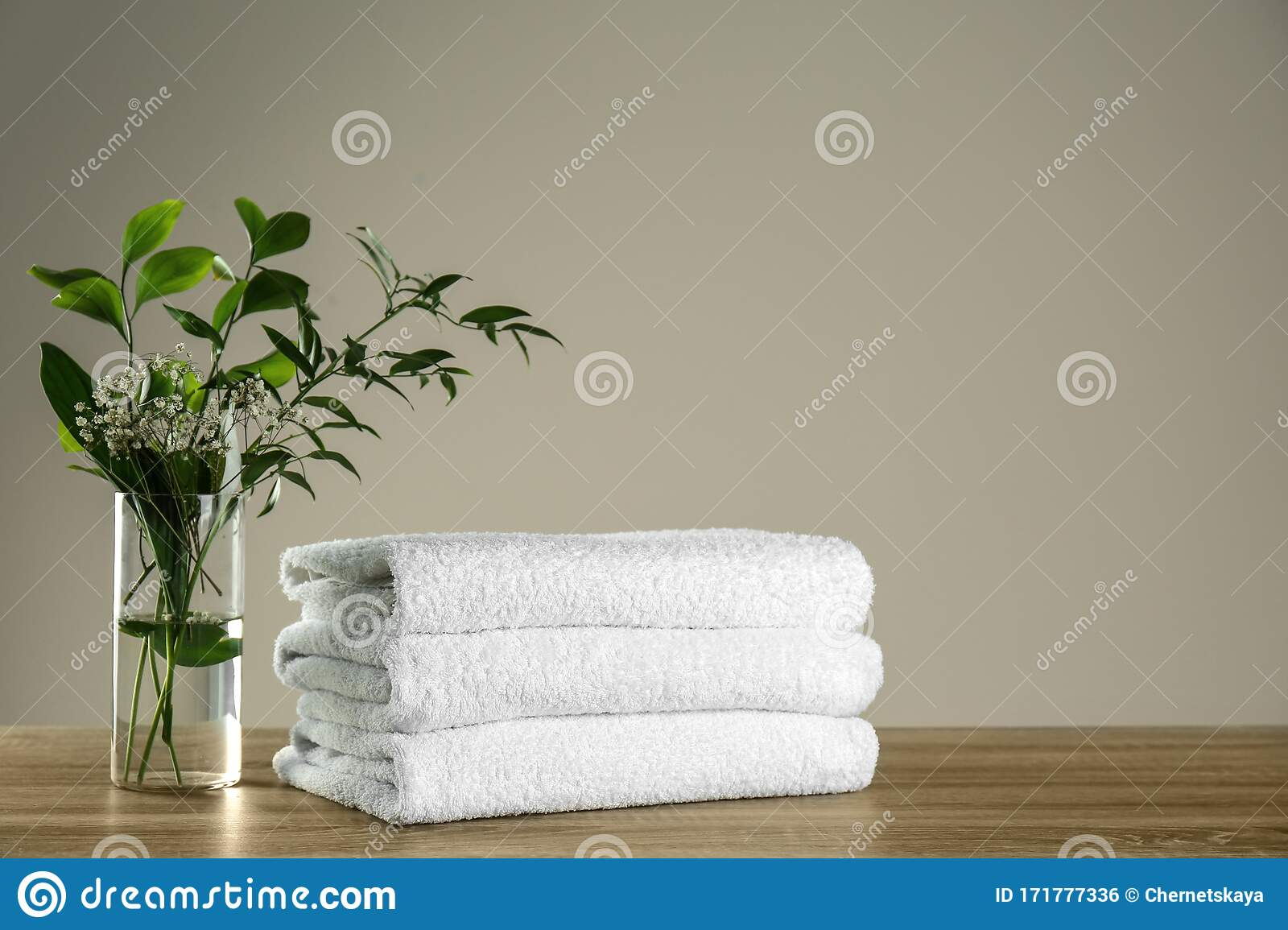 Clean Bath Towels And Vase With Green Plants On Table Space For Text Stock Photo Image Of Hygiene Plants 171777336