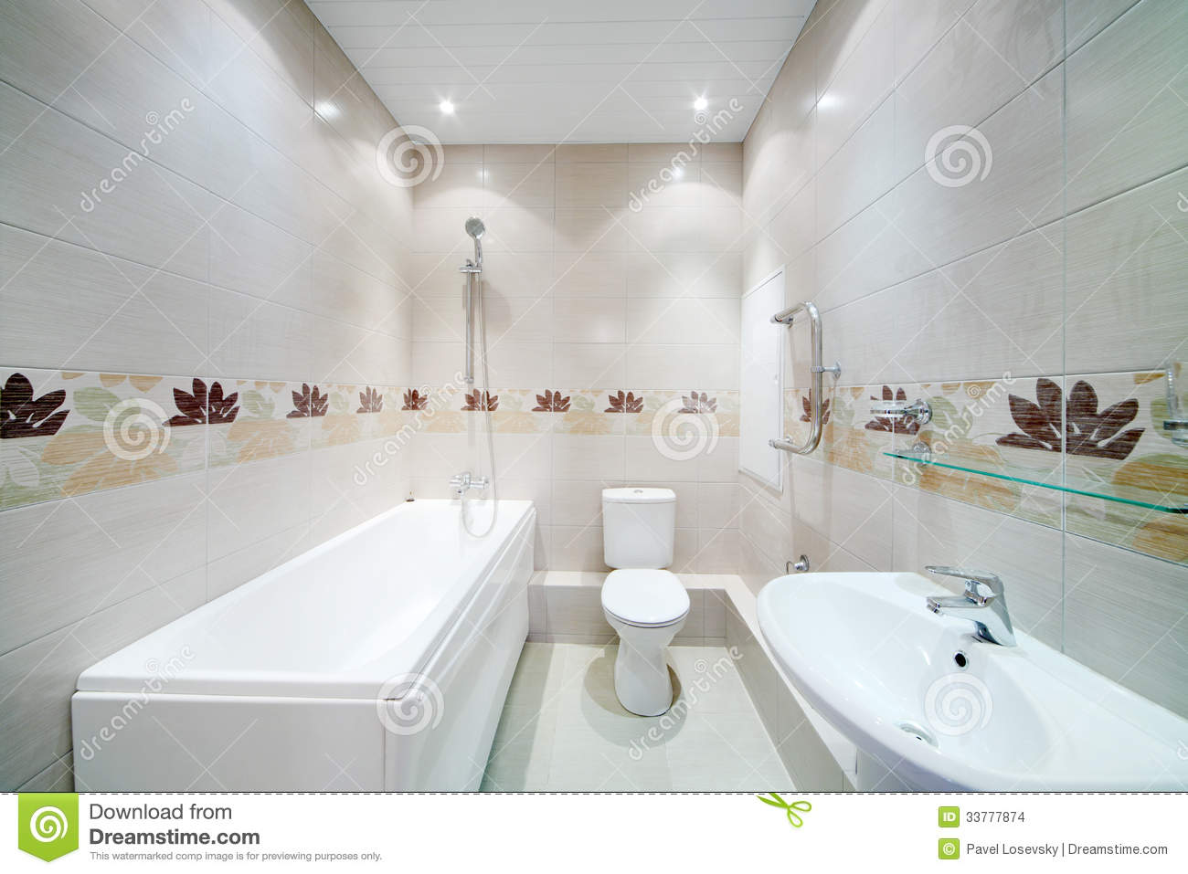 Clean Bathroom With Toilet With Simple Grey Tiles Stock