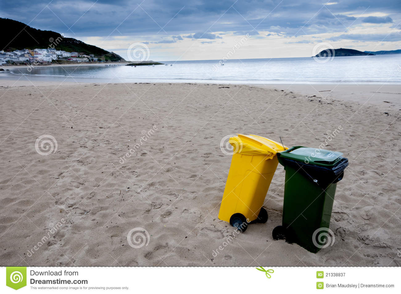 clean beach and recycling bins royalty free stock