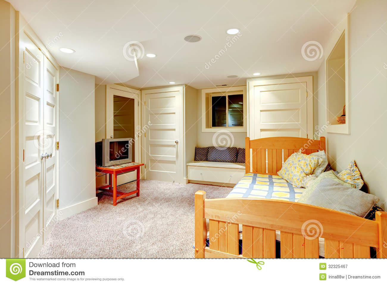 Clean And Bright Basement Bedroom With White Walls And Carpet Royalty