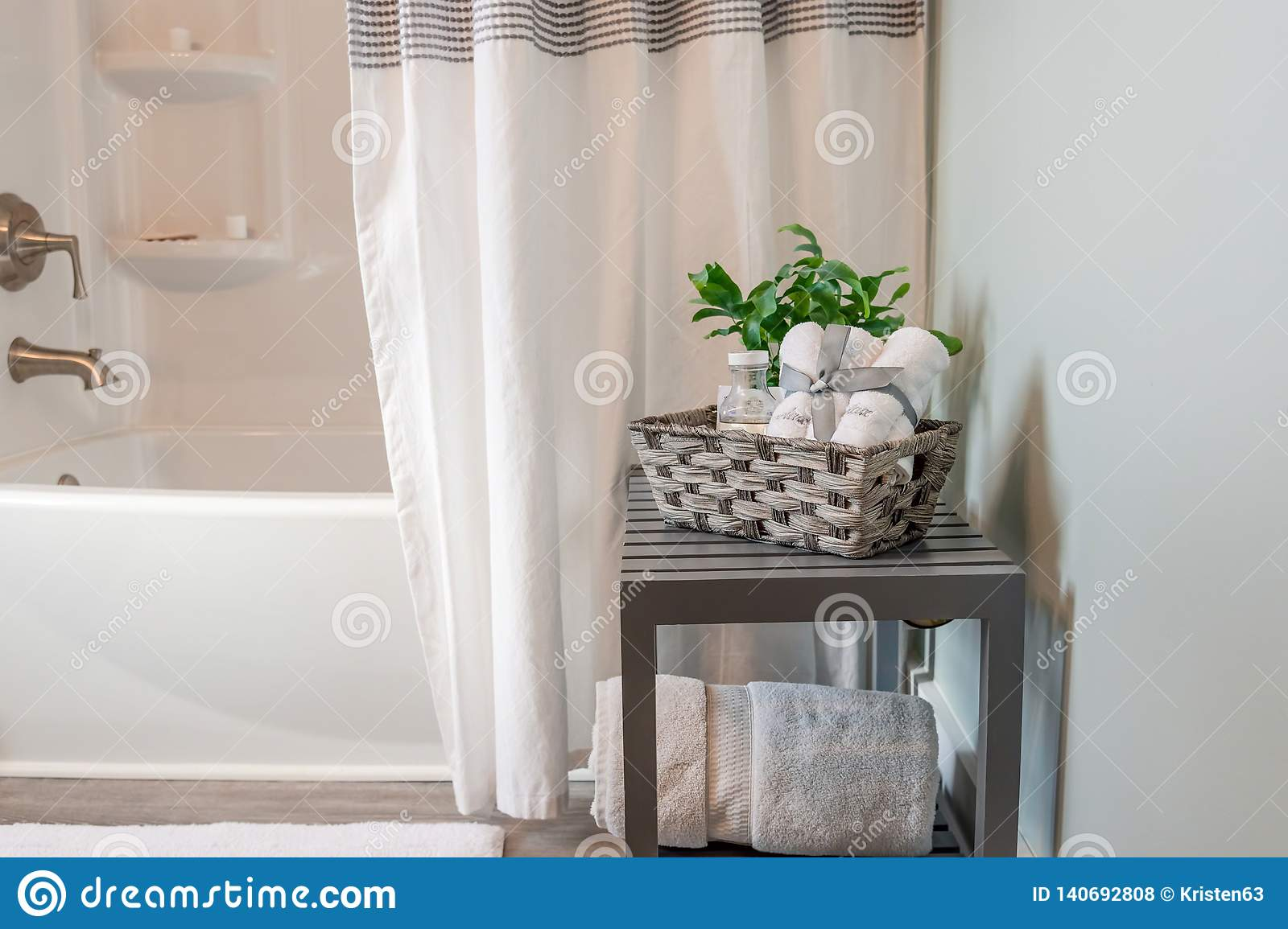 Clean And Bright Bathroom Decor In Gray And White Stock