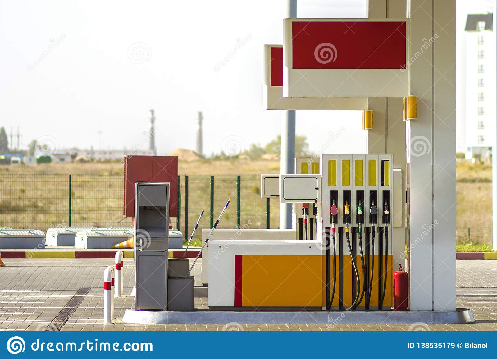 Clean empty auto gas station exterior on sunny day on rural landscape and bright sky copy space background