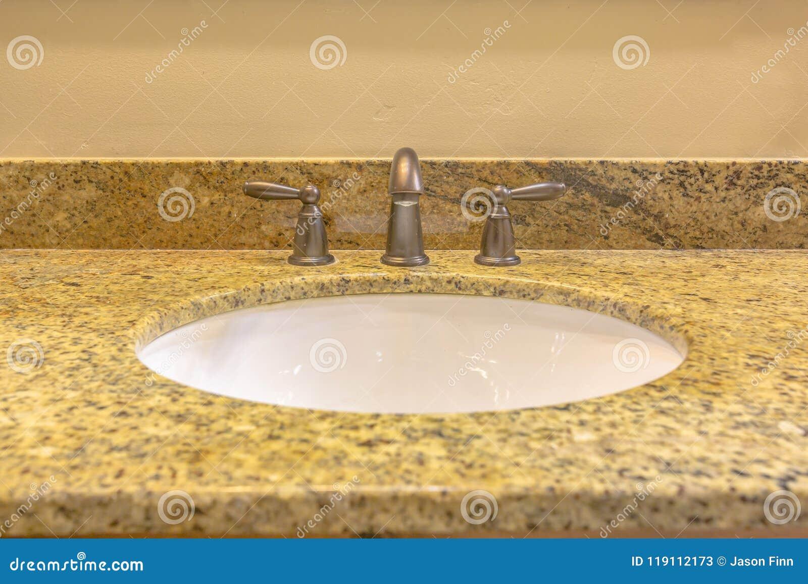 Clean granite sink in bathroom of model home