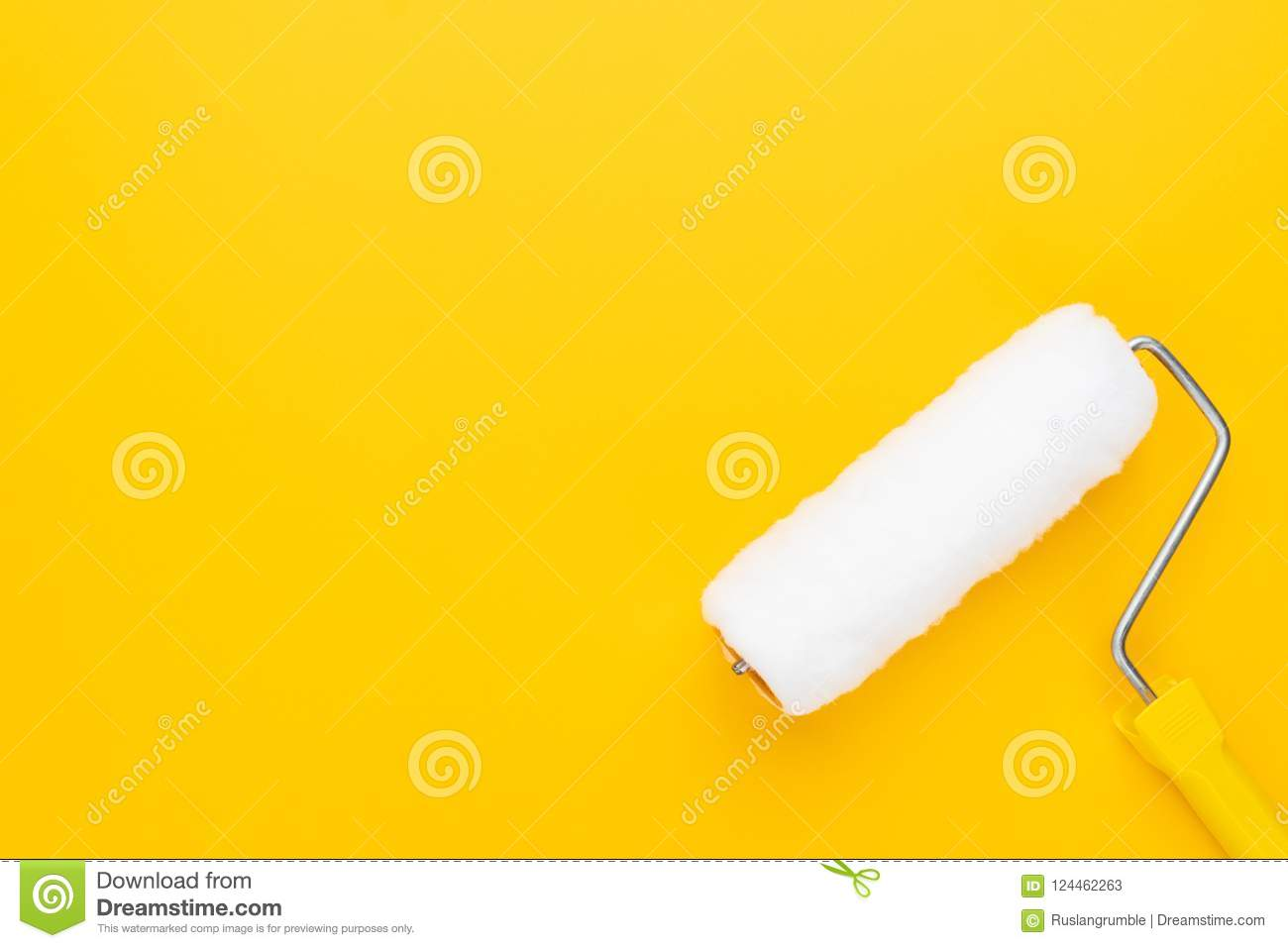 Clean paint roller on the yellow background with copy space