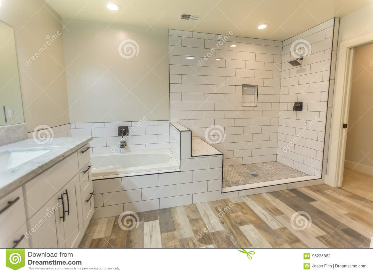 Clean Spacious Master Bedroom Bathroom With Shower And Tub
