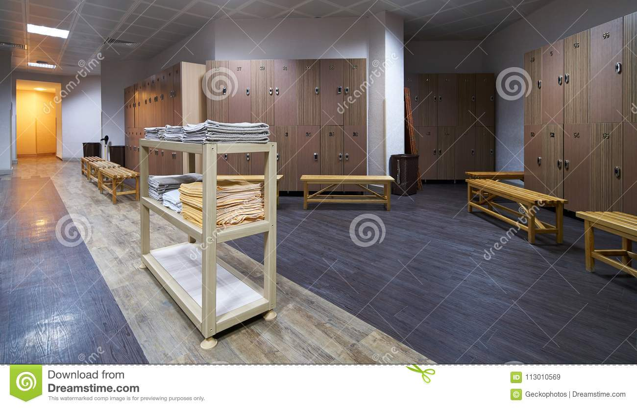 Astonishing Clean Towels Shelf In A Locker Room With Wooden Benches In Ncnpc Chair Design For Home Ncnpcorg