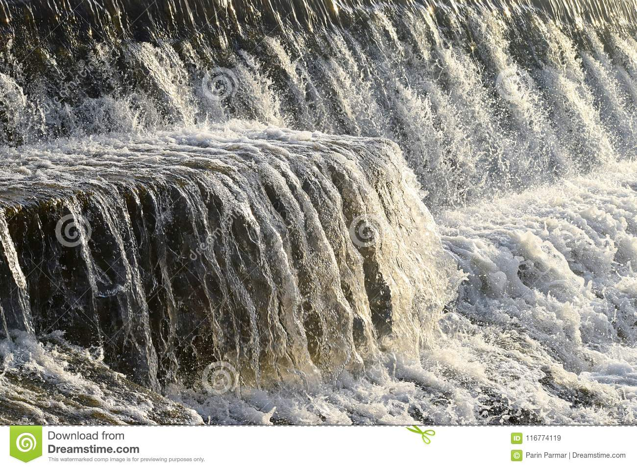 Clean Water Flowing over Stone and Sprinkles of Drops