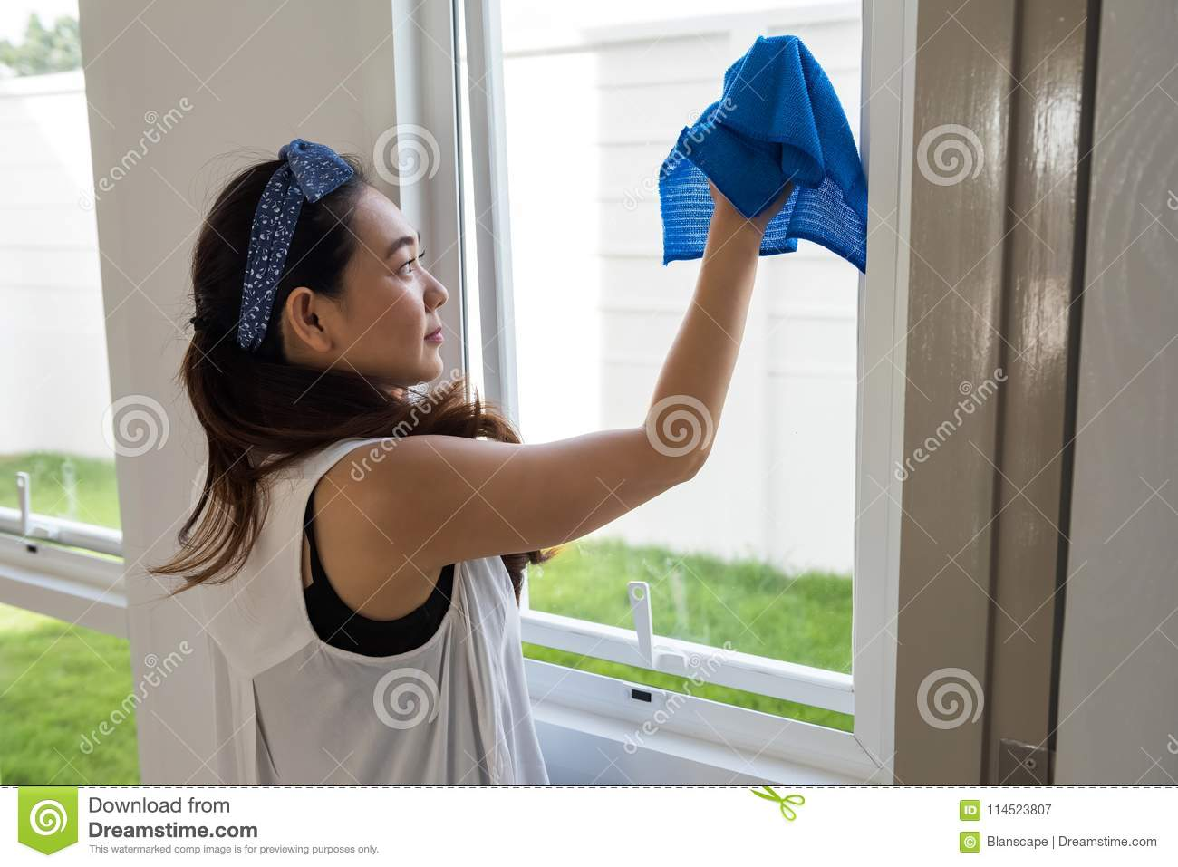 clean window of new house by microfiber fabric