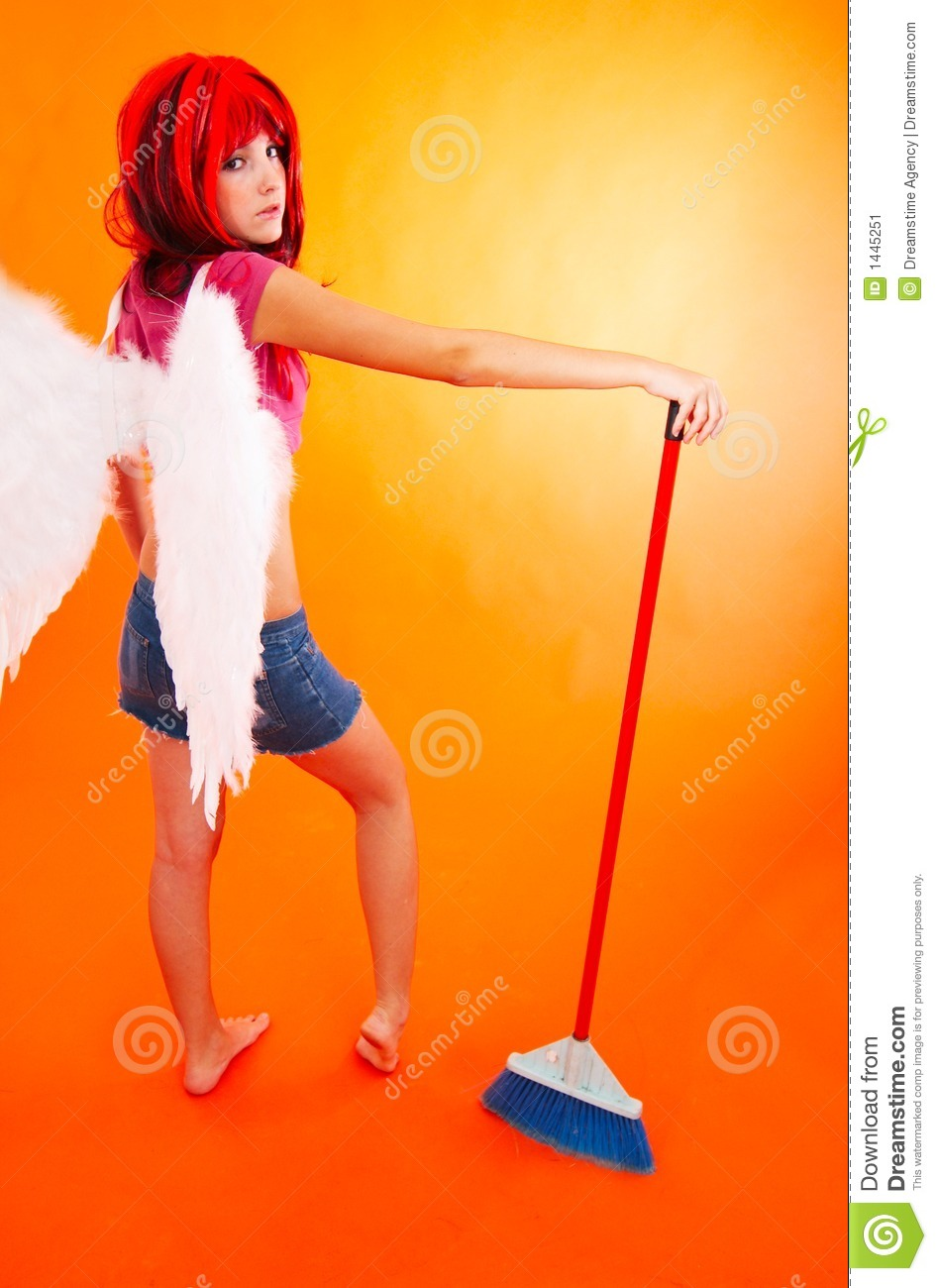 cleaning angel spreads her wings  stock image