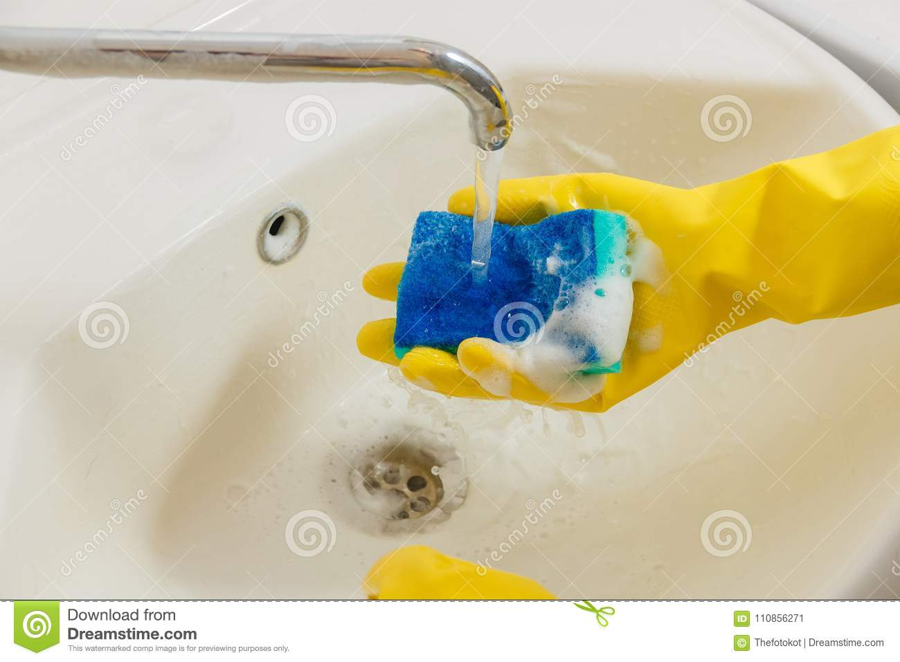 Cleaning Bathroom Faucet With Detergent In Yellow Rubber Gloves With ...