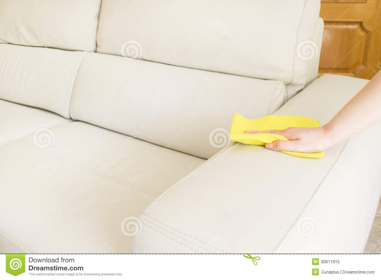 Cleaning A Beige Sofa Royalty Free Stock Photo Image