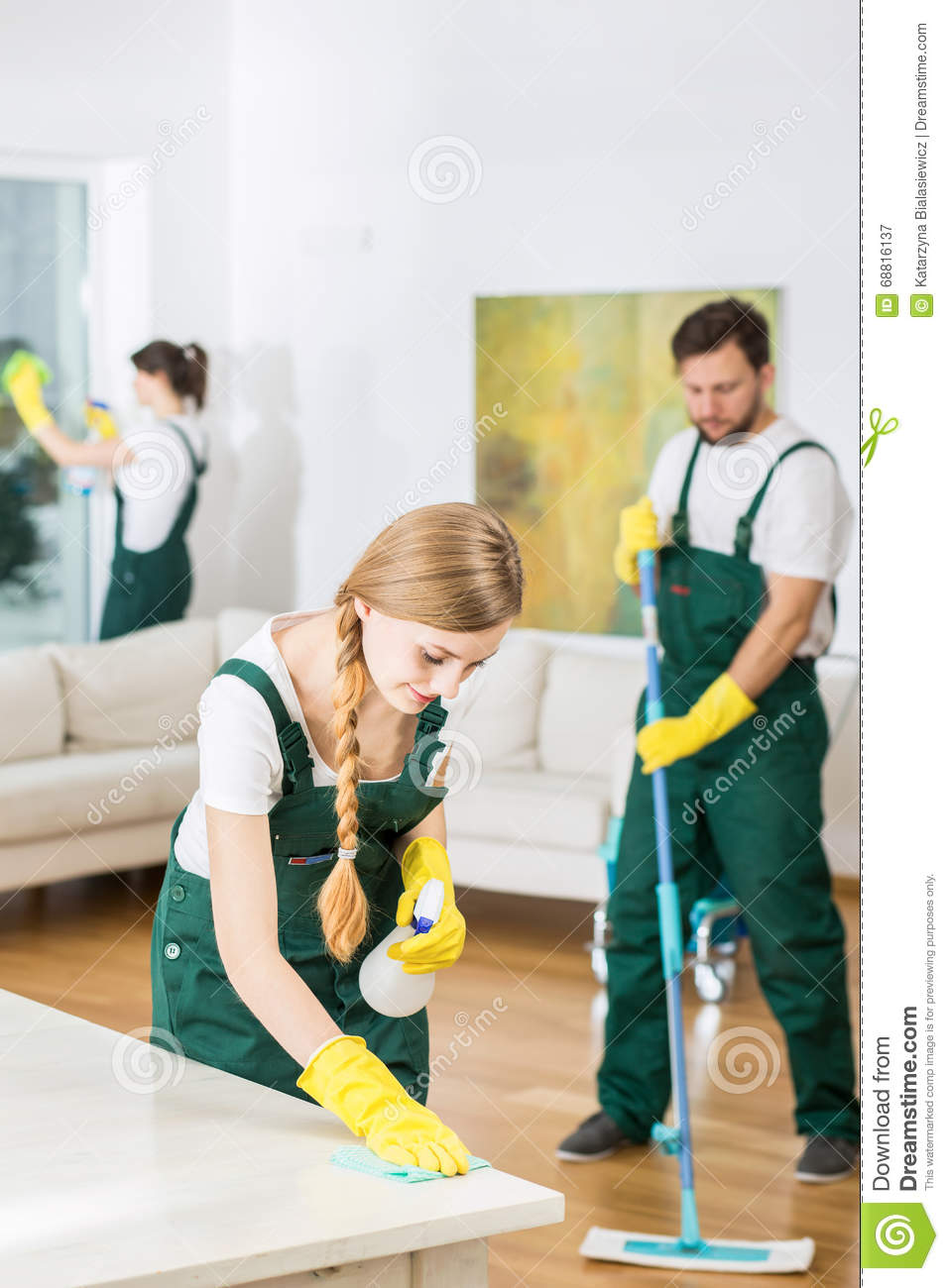 People Cleaning Services : Cleaning company and spacious living room stock image