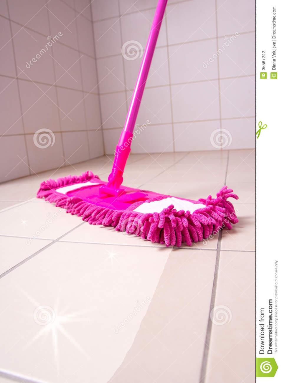 Cleaning The Floor With Pink Mop Stock Photography