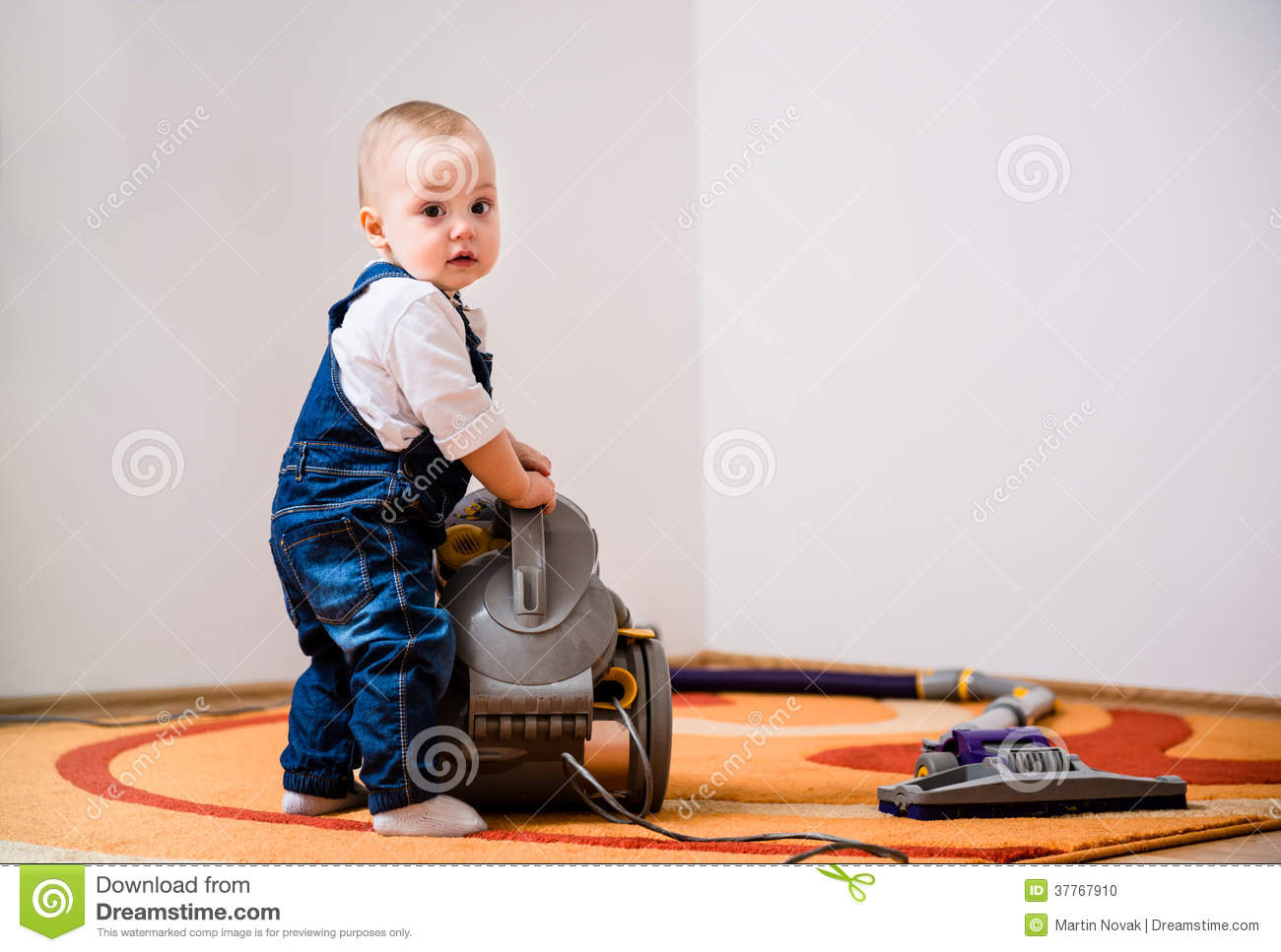 Cleaning Home Baby With Vacuum Cleaner Stock Photo