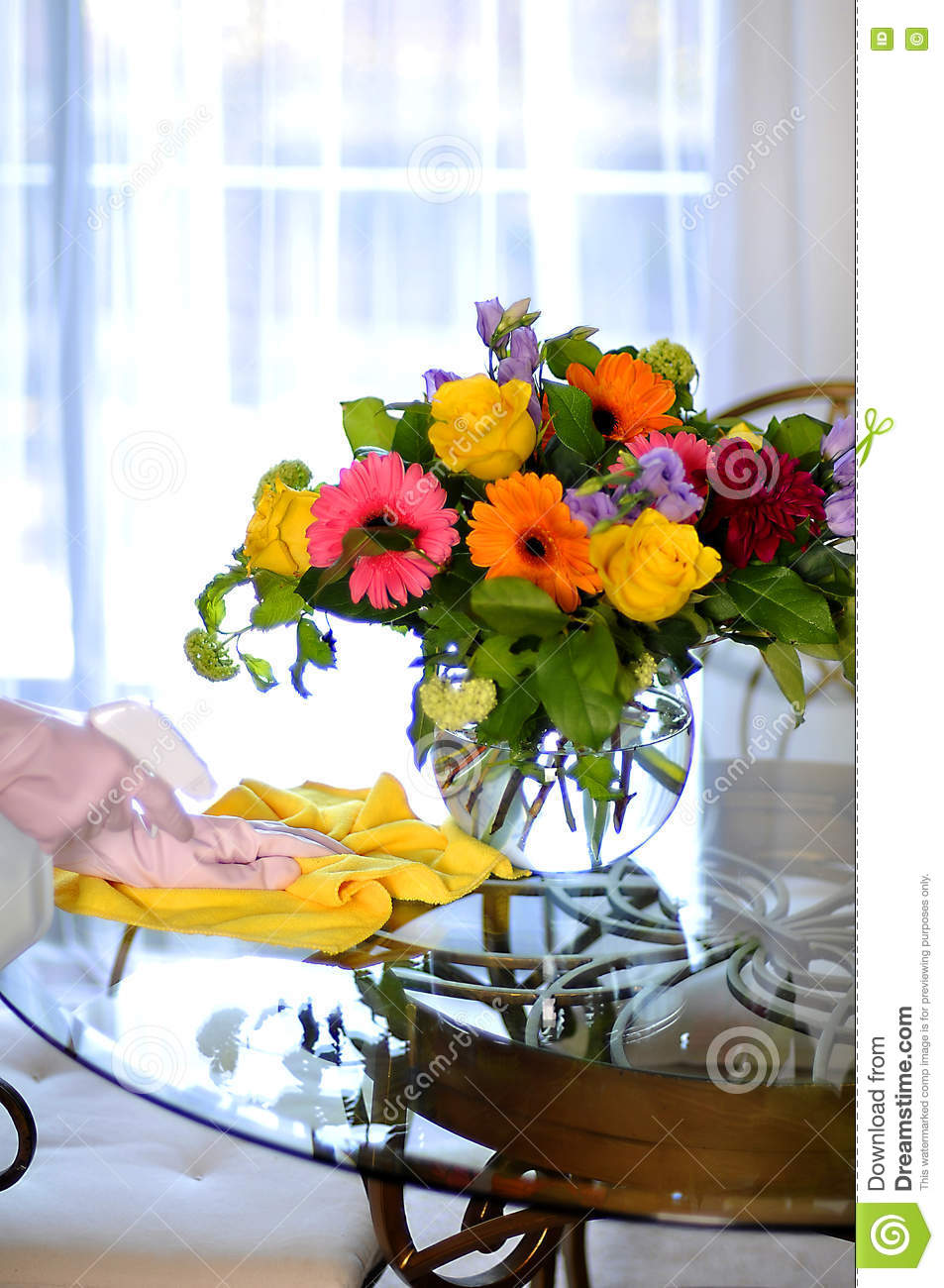 Cleaning House Spray And Towel Near Flowers On Table Stock Photo