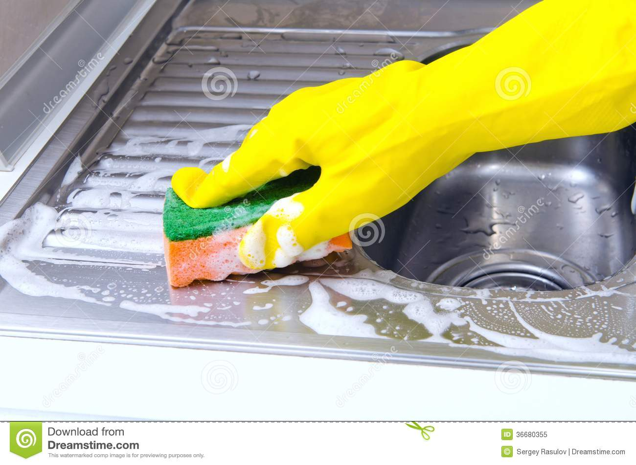 Cleaning the kitchen sink & Cleaning the kitchen sink stock image. Image of shiny - 36680355