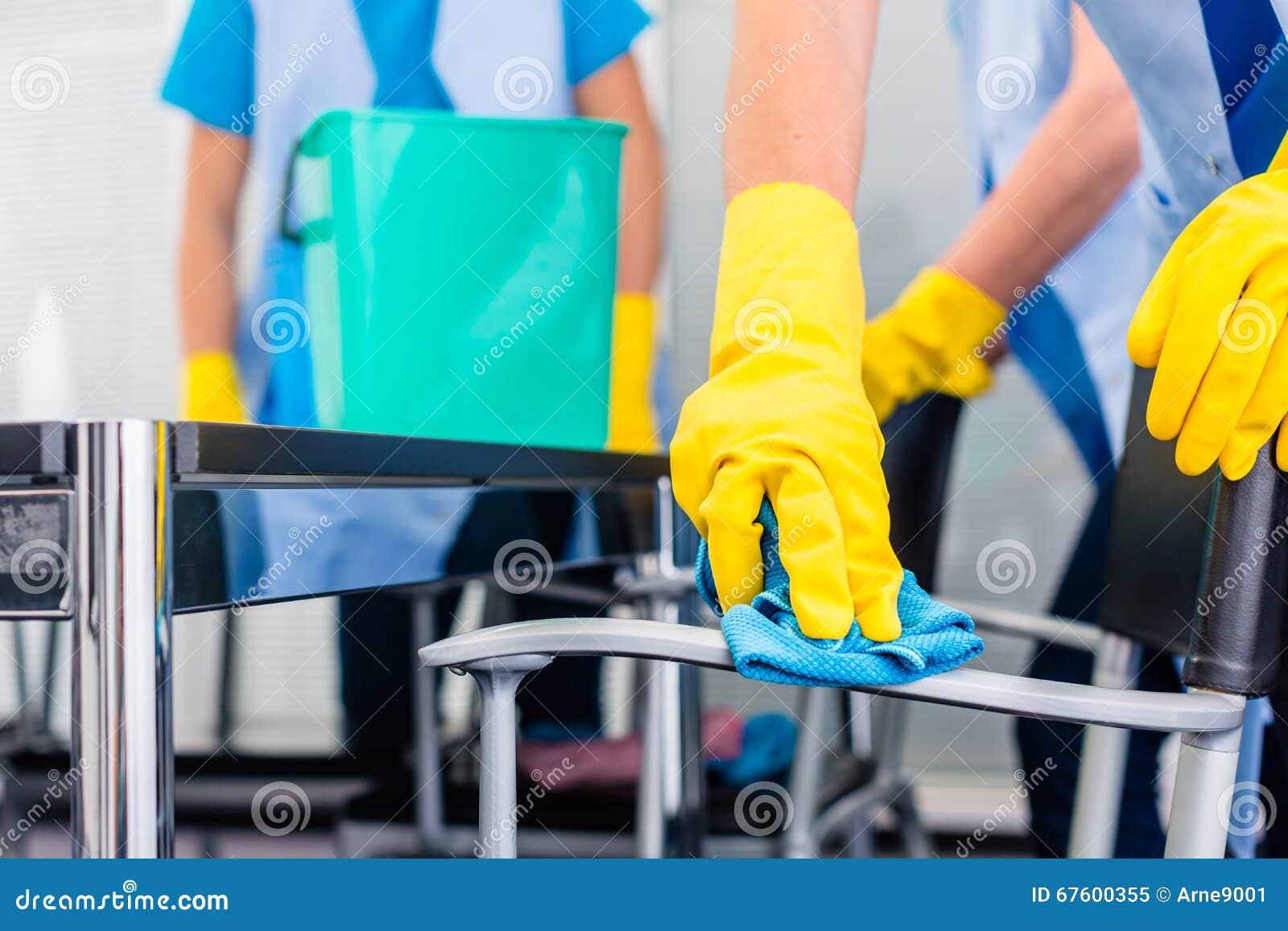 Cleaning ladies working as team in office