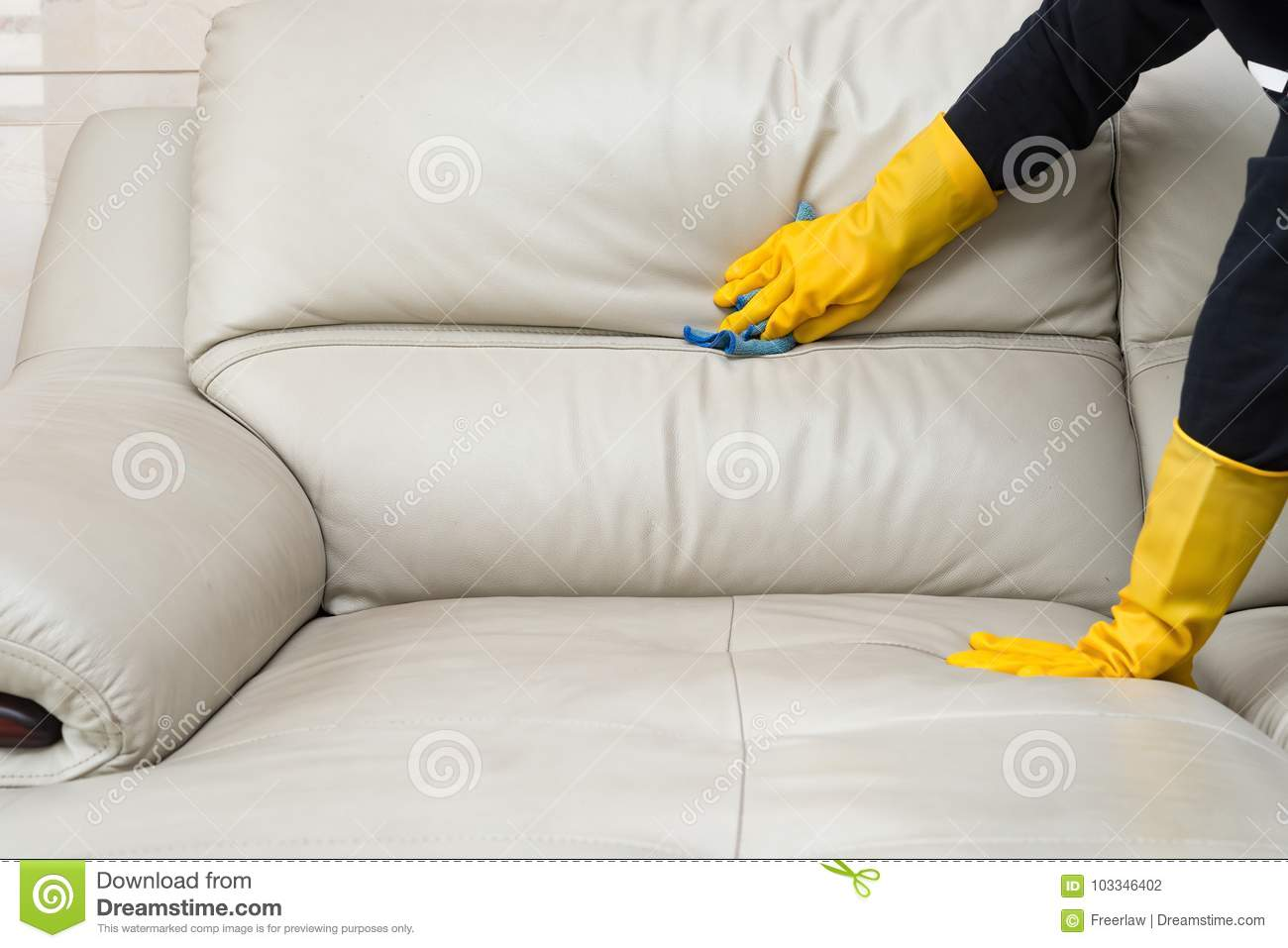 Cleaning leather sofa stock photo. Image of dust, household ...