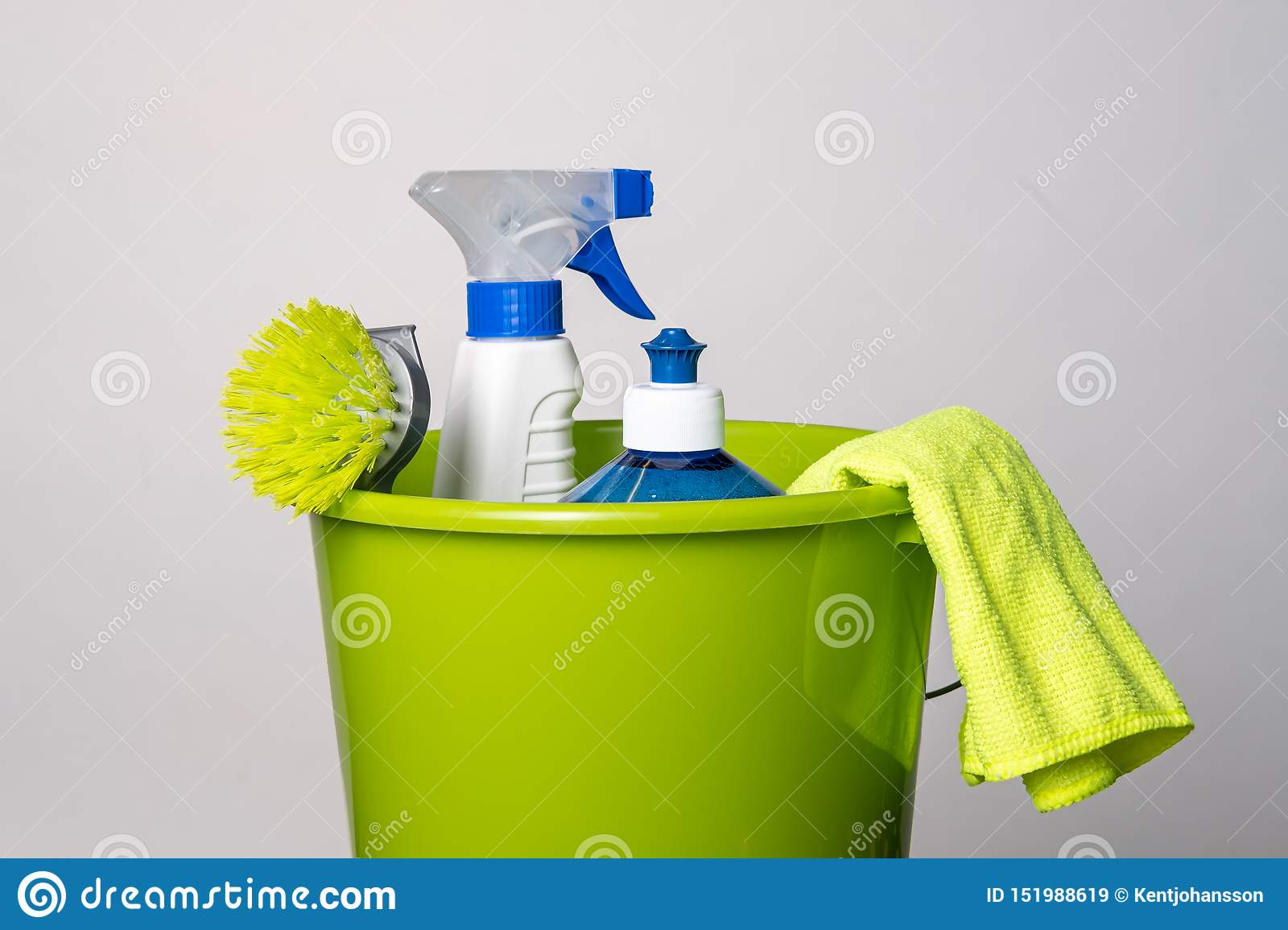 Cleaning products in green bucket