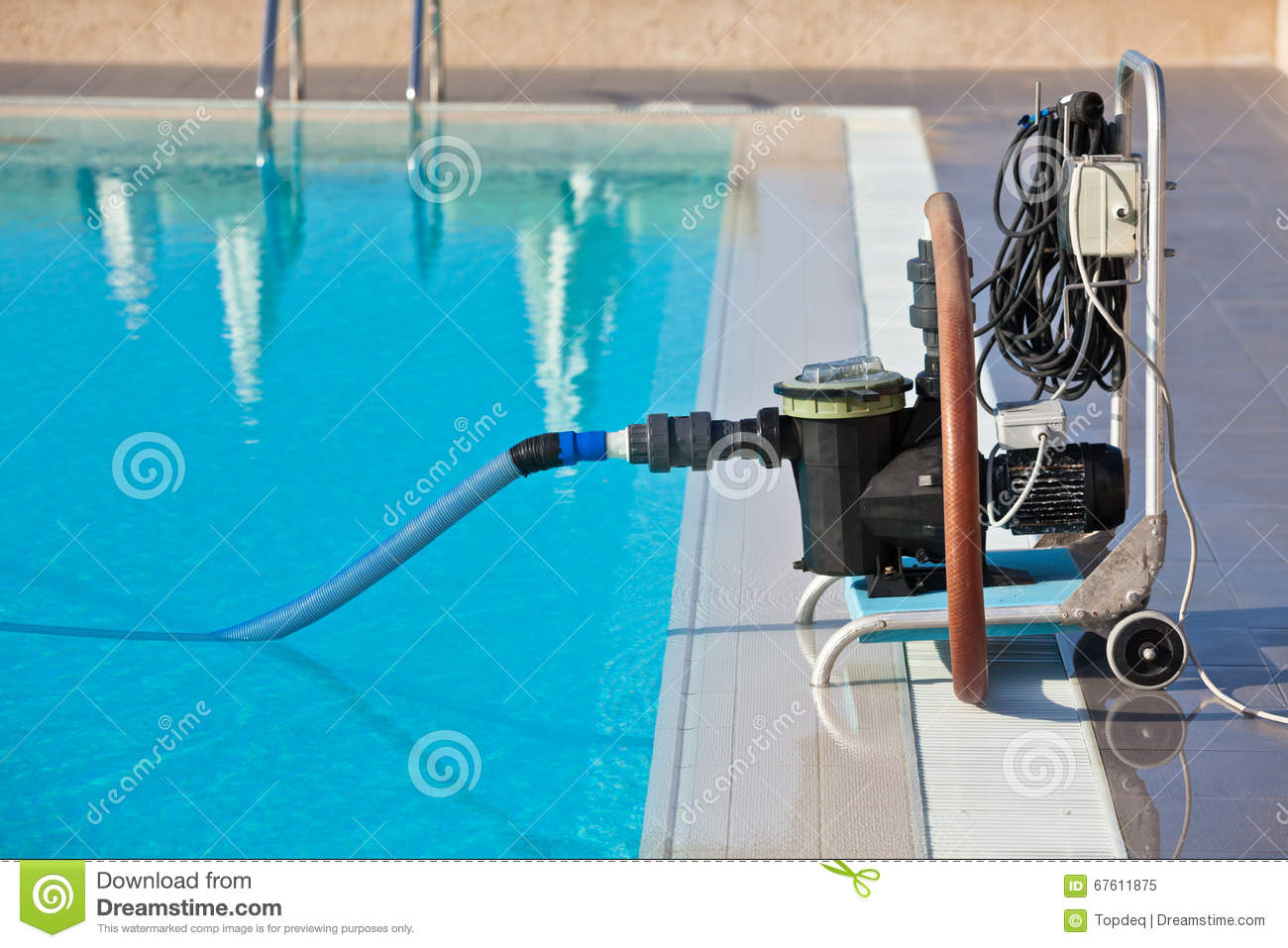 Cleaning Swimming Pool Pump : Cleaning pump working with a swimming pool stock image